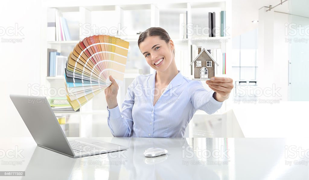 smiling woman in office, concept for architecture and constructi stock photo