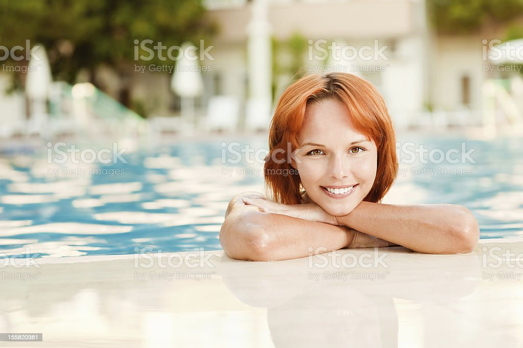 Smiling woman in   pool stock photo