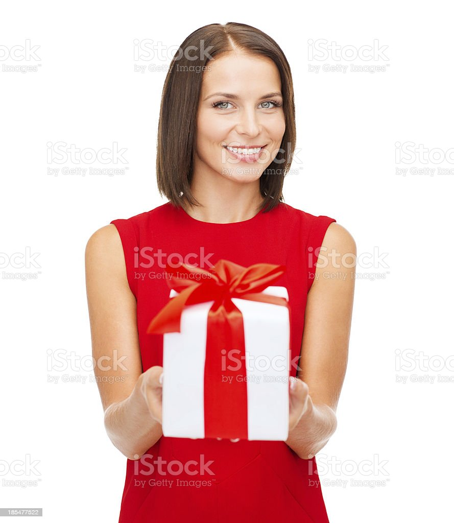 smiling woman in red dress with gift box royalty-free stock photo