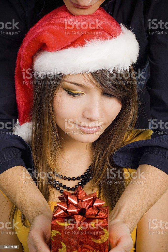 Smiling woman in santa hat royalty-free stock photo