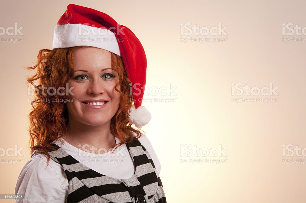Smiling woman in santa's hat royalty-free stock photo