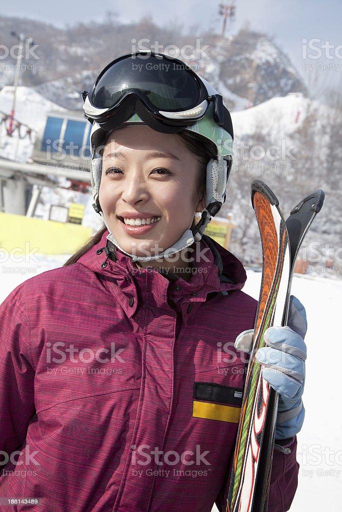 Smiling Woman in Ski Resort stock photo