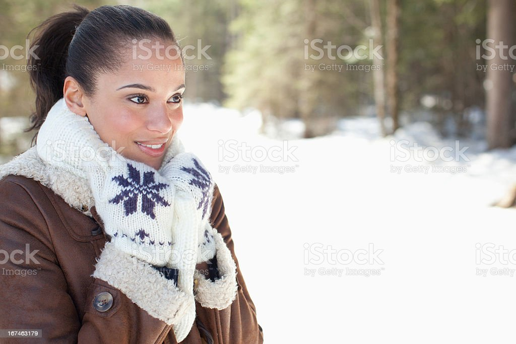 Smiling woman in snowy woods royalty-free stock photo