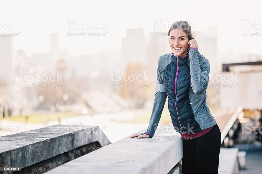 Smiling woman in sports wear stock photo