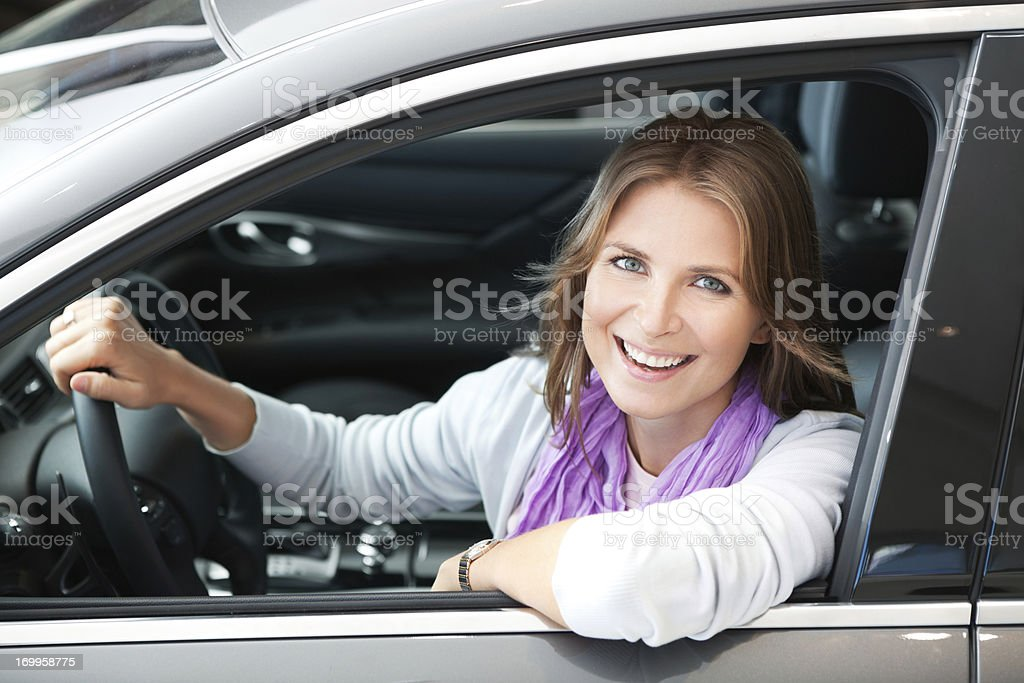 Smiling woman in stationary car royalty-free stock photo