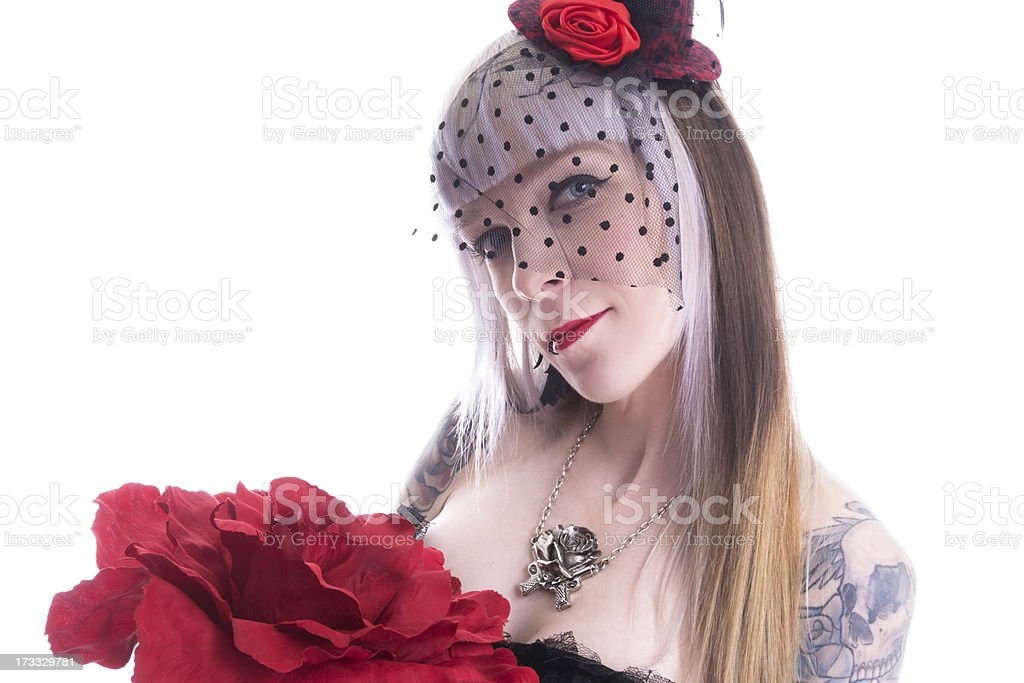 Smiling woman in veil with giant rose. royalty-free stock photo