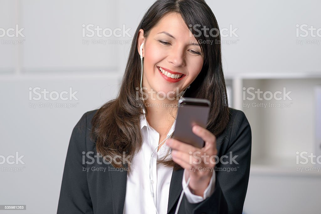 Smiling woman listening to music stock photo