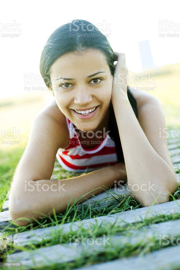 smiling woman looking at camera royalty-free stock photo
