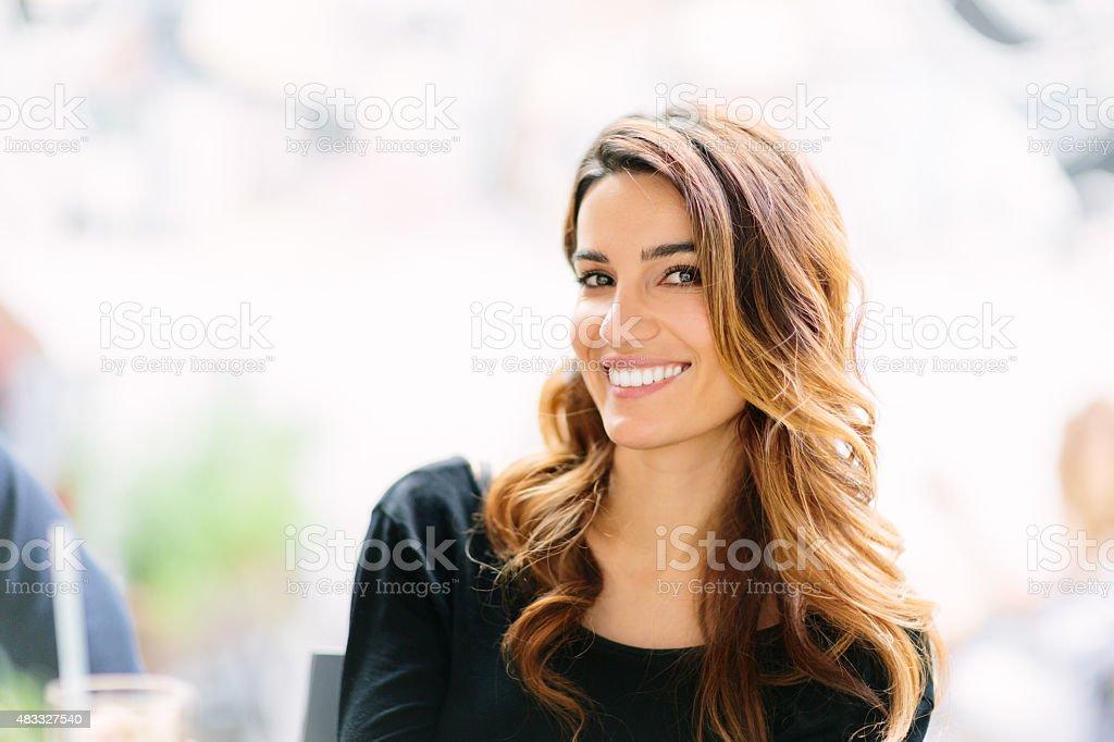 Smiling woman looking at camera stock photo