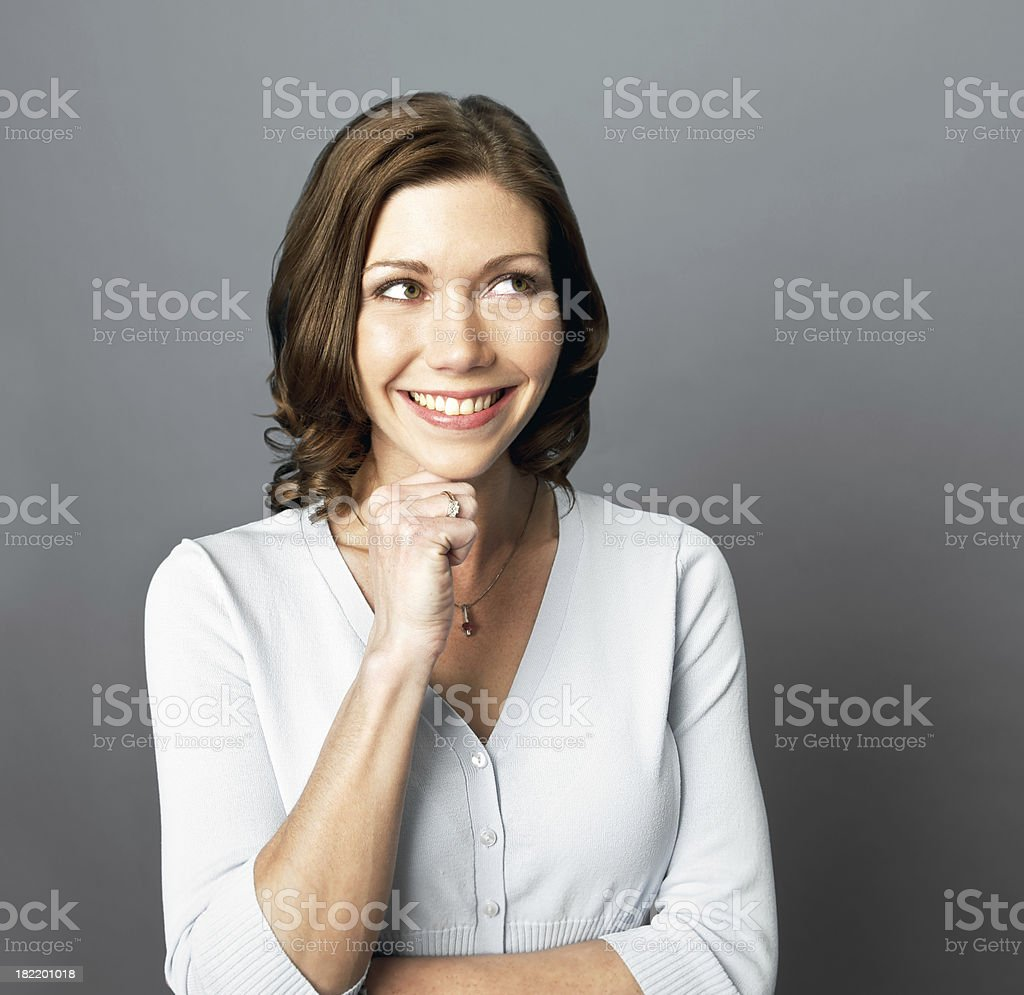 Smiling Woman Looks Up royalty-free stock photo