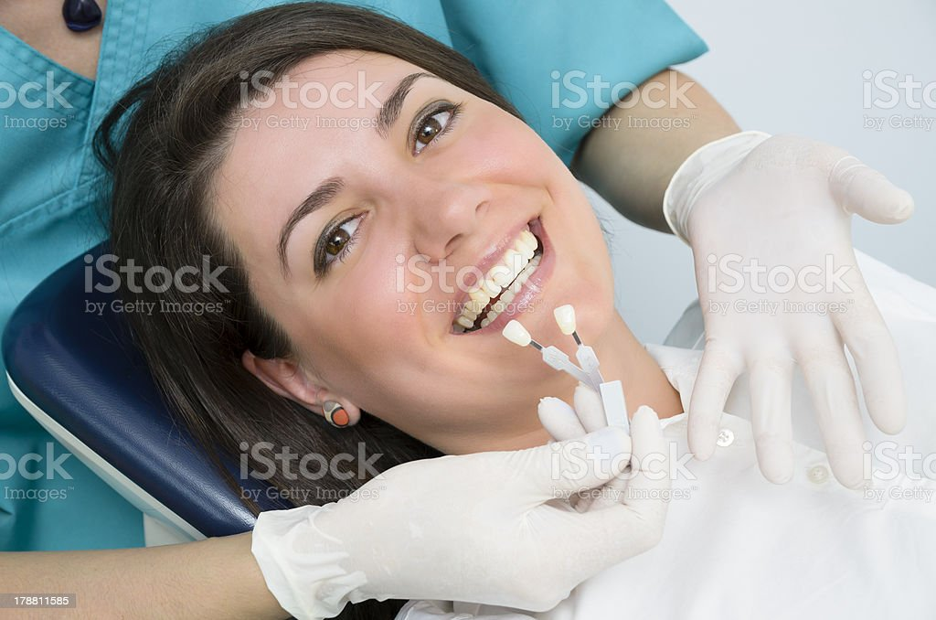 Smiling woman lying in a dental chair stock photo