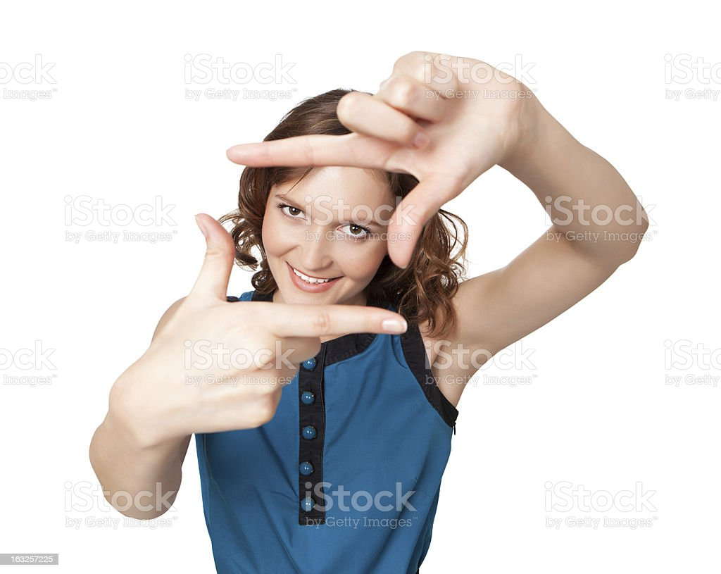 Smiling woman making a frame with fingers royalty-free stock photo