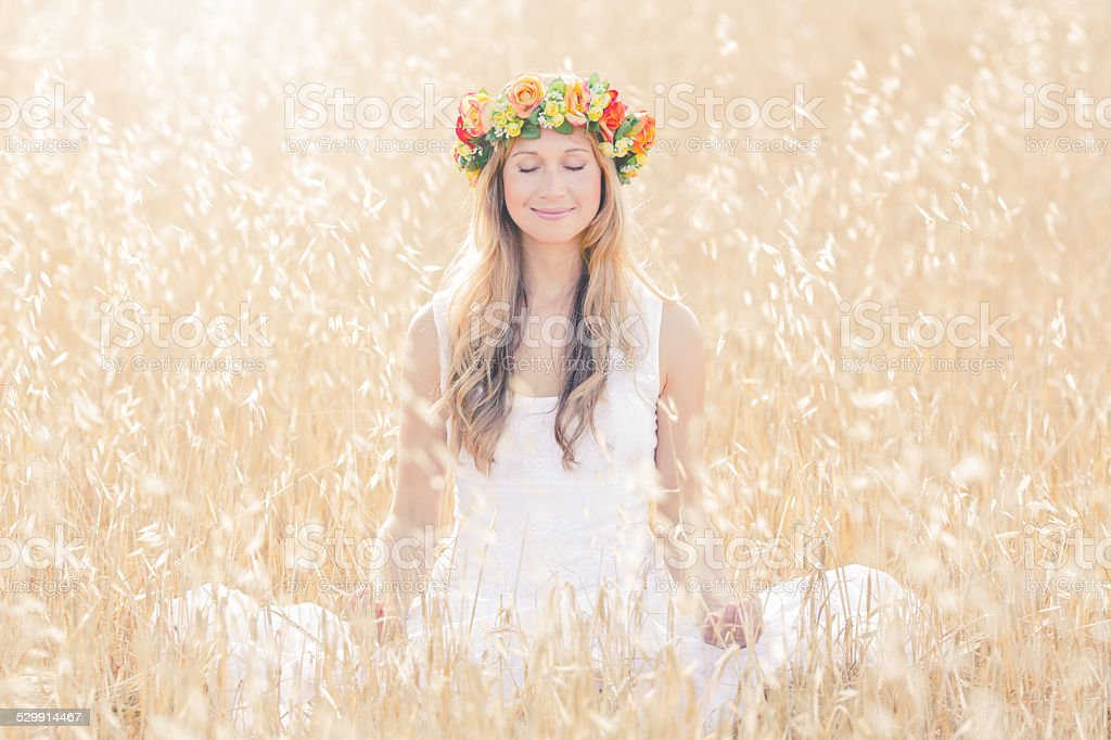 smiling woman meditating in the nature stock photo