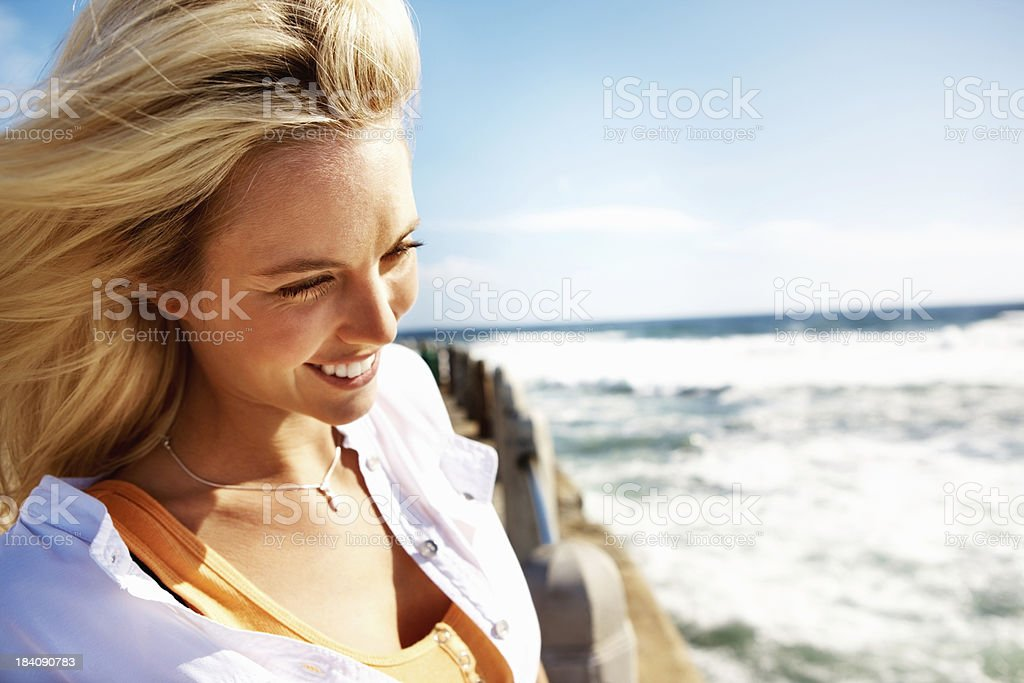Smiling woman on a pier royalty-free stock photo
