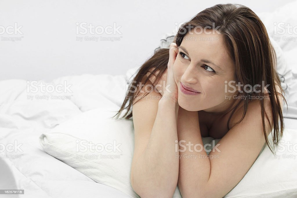 Smiling woman on bed royalty-free stock photo