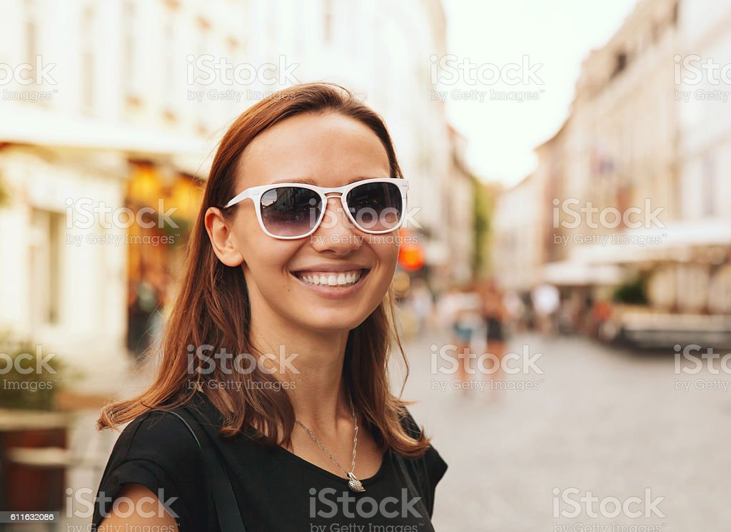 Smiling Woman on the Background of European Old Town Street stock photo