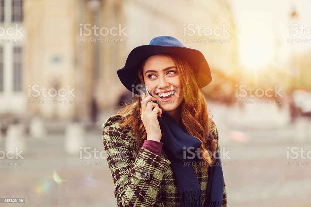 Smiling woman on the phone stock photo