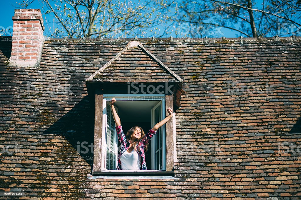 Smiling woman on the rooftop window stock photo