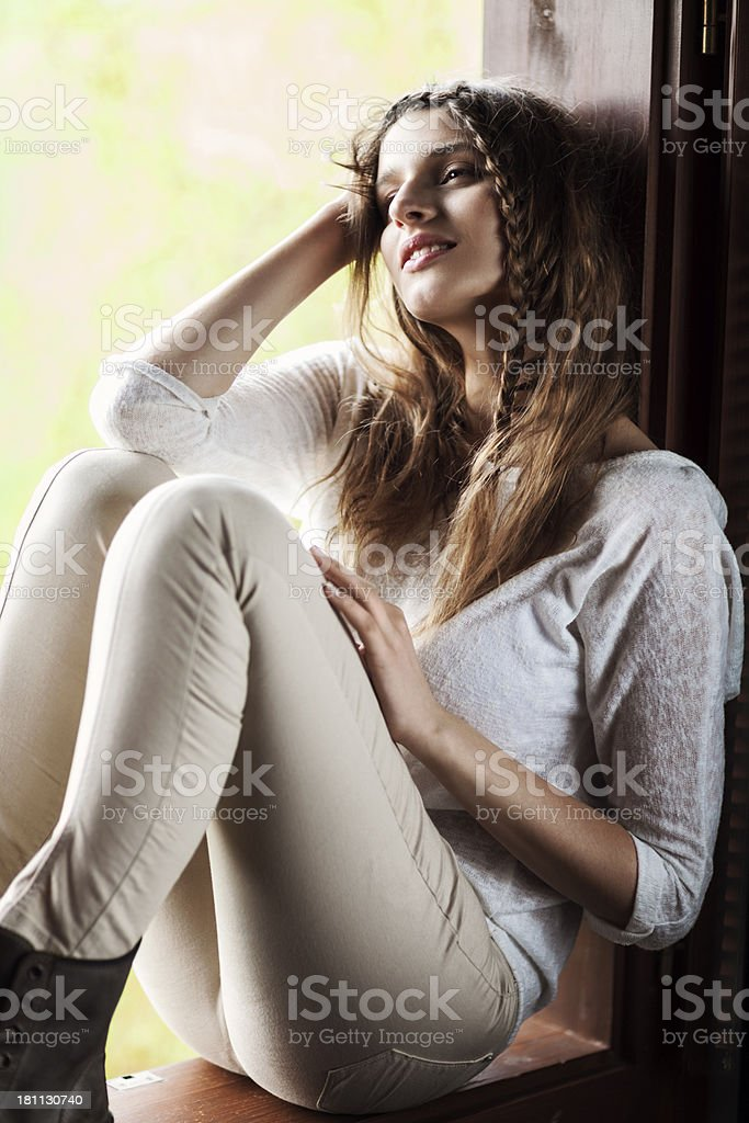 Smiling Woman On Window Sill royalty-free stock photo