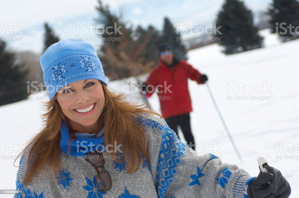 Smiling Woman Out Cross-country Skiing stock photo