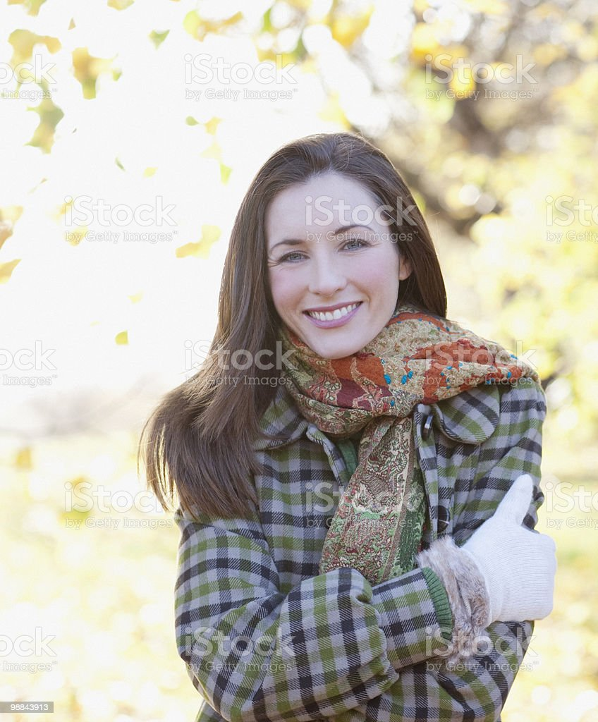 Smiling woman outdoors in autumn stock photo
