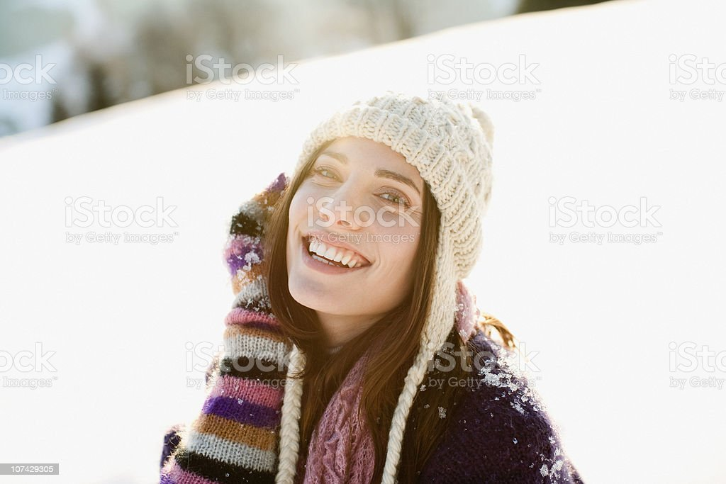 Smiling woman outdoors in snow royalty-free stock photo