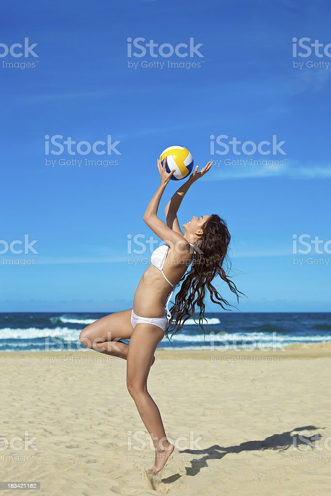Smiling woman playing volleyball royalty-free stock photo