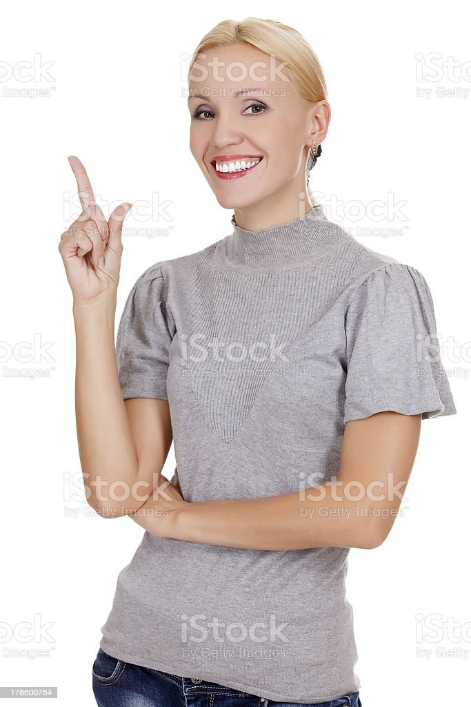 Smiling woman pointing at something interesting royalty-free stock photo