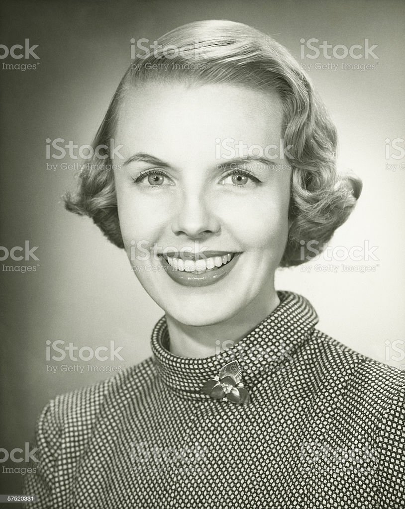 Smiling woman posing in studio, (B&W), portrait, close-up stock photo