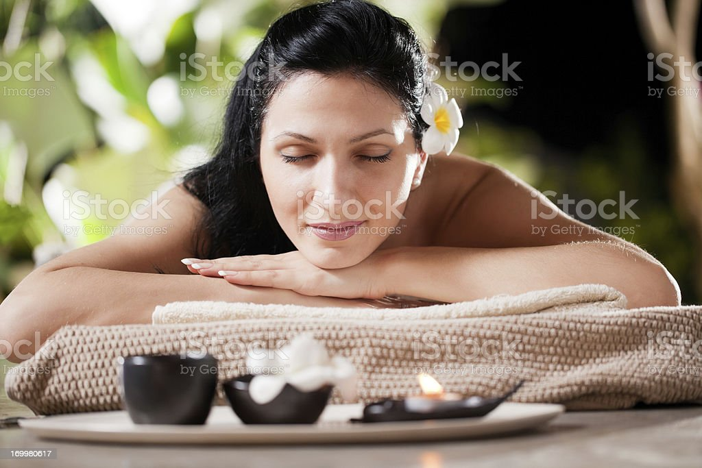 Smiling woman prepared for massage at the spa resort. royalty-free stock photo