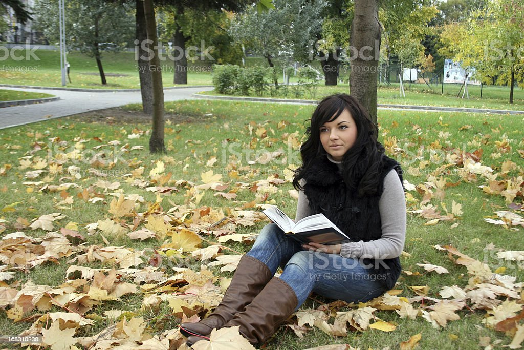 Smiling woman reading a book royalty-free stock photo