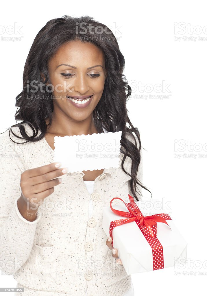 Smiling woman reading message on greeting card. stock photo