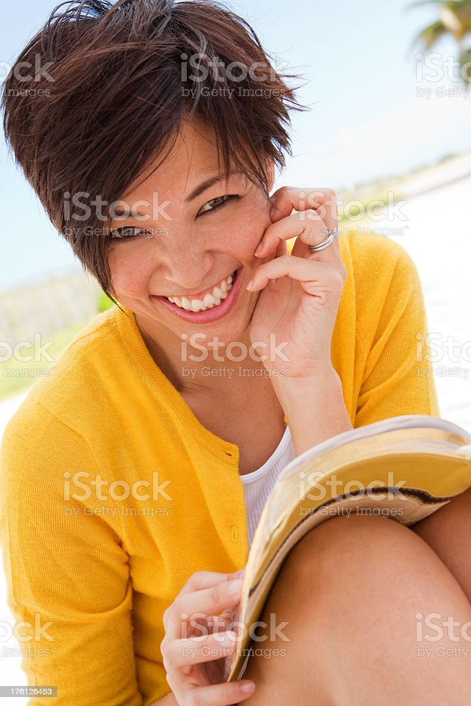 Smiling Woman Reading royalty-free stock photo