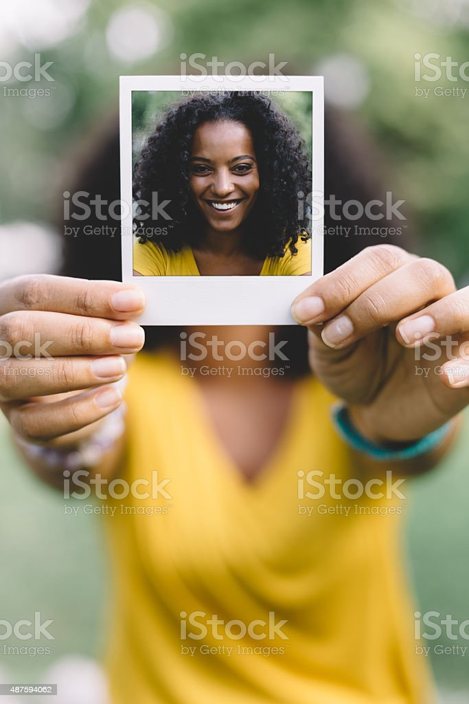 Smiling woman showing selfie stock photo