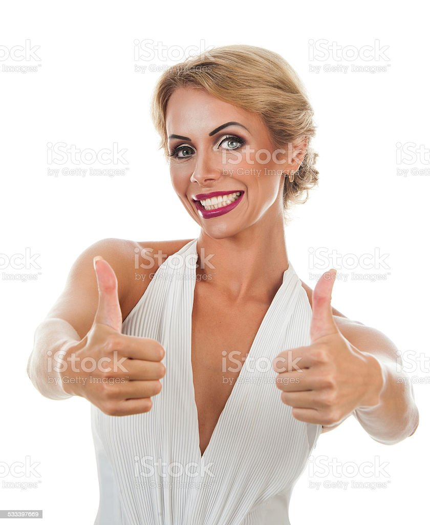 Smiling woman showing tumb sign stock photo