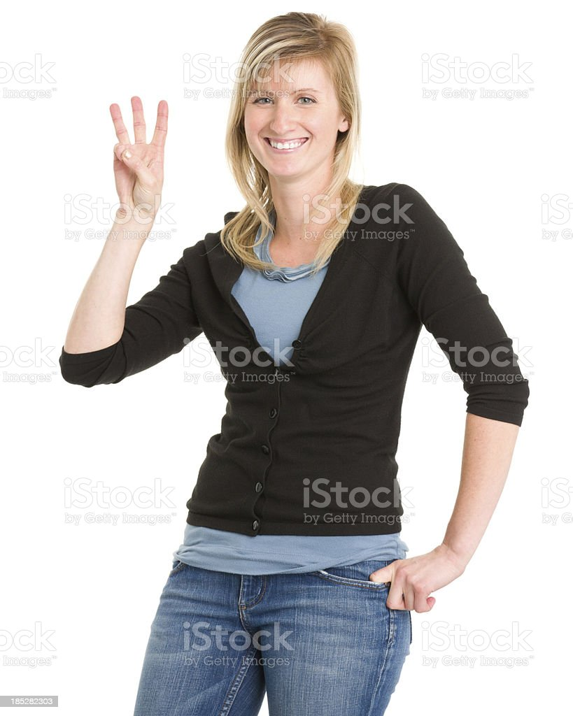 Smiling Woman Shows 3 Fingers stock photo