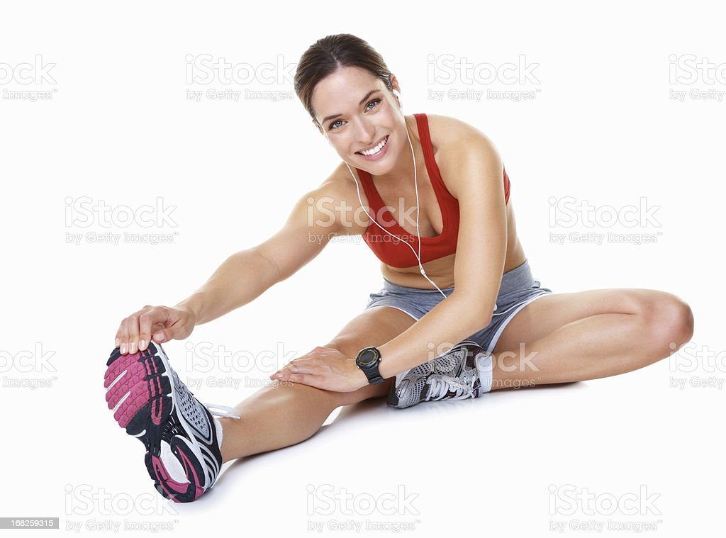 Smiling woman sitting and stretching royalty-free stock photo