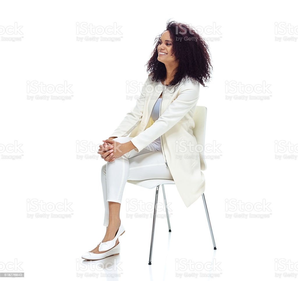 Smiling woman sitting on chair stock photo