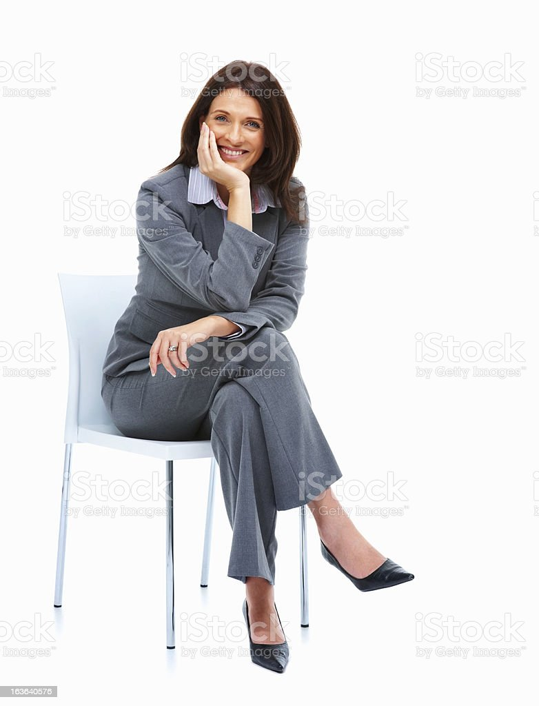 Smiling Woman Sitting On Office Chair Stock Photo