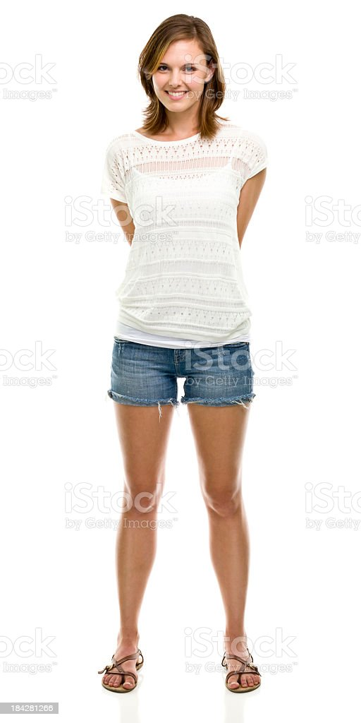 A smiling woman, standing against a white background  stock photo