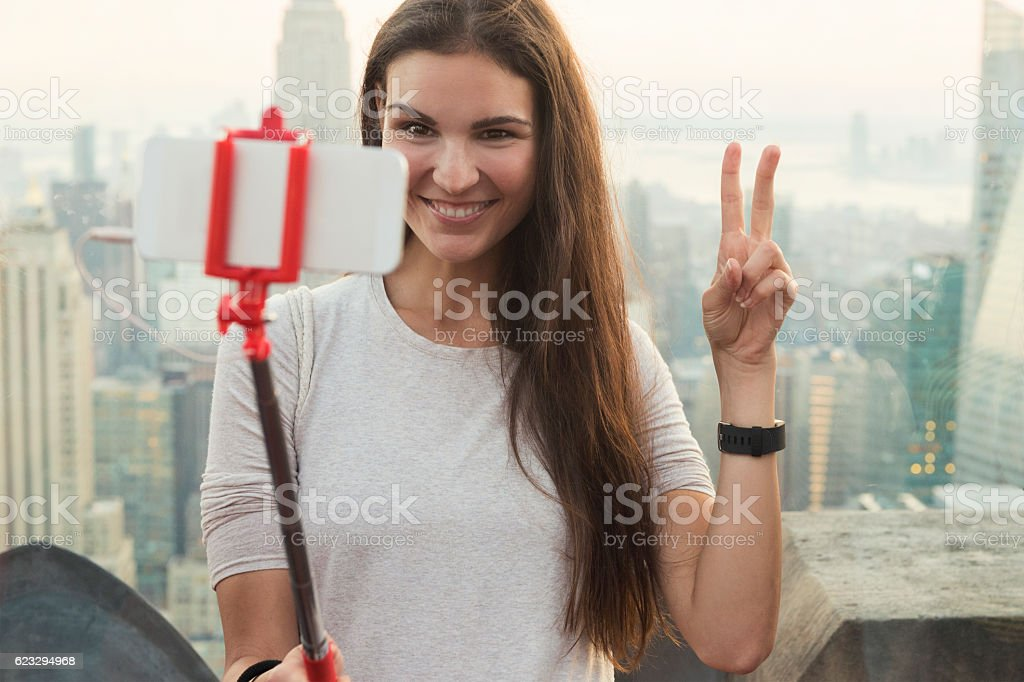 Smiling Woman Taking a Selfie in Manhattan, New York City stock photo