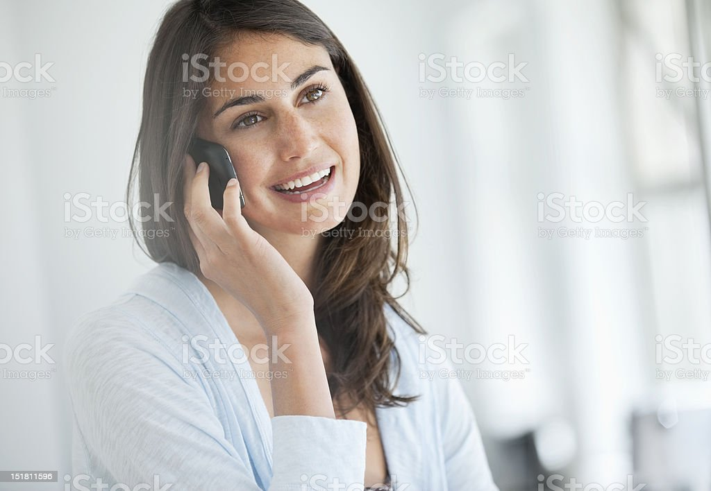 Smiling woman talking on cell phone stock photo
