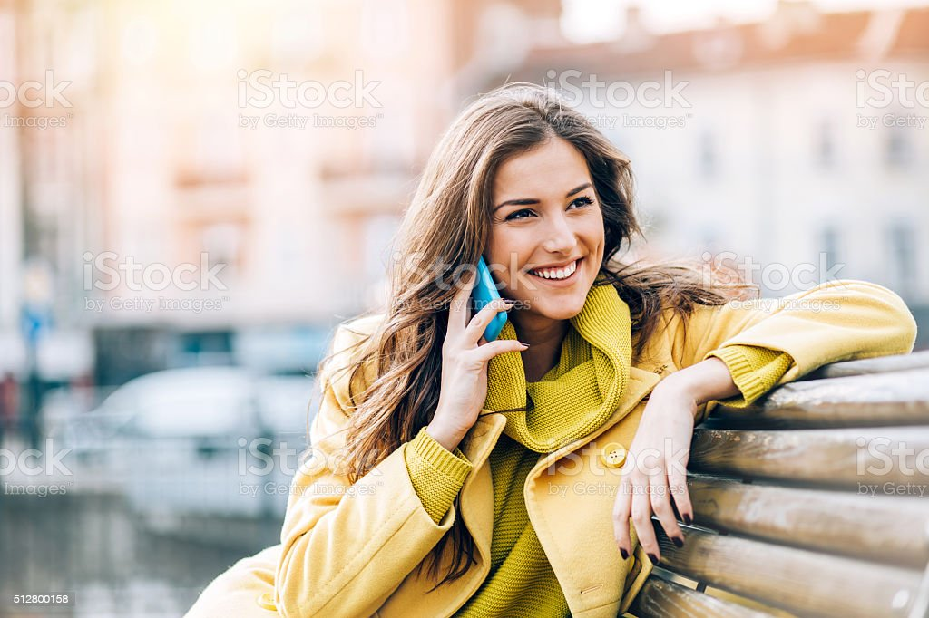 Smiling woman talking on the phone stock photo