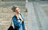 Smiling woman talking on the phone.