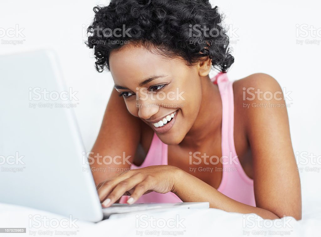 Smiling woman typing on laptop royalty-free stock photo