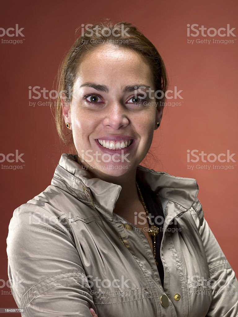 Smiling woman wearing a raincoat stock photo