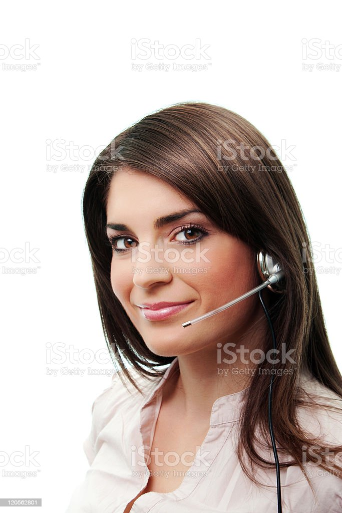 Smiling woman wearing a telephone headset at a call desk stock photo