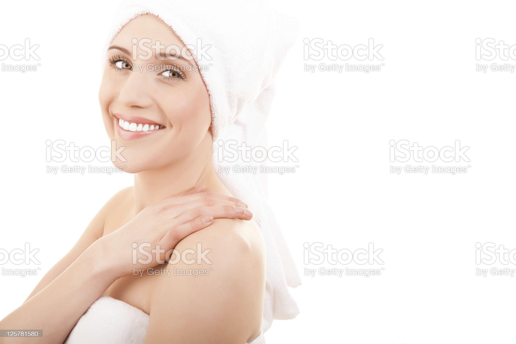 Smiling woman wearing bath towel royalty-free stock photo