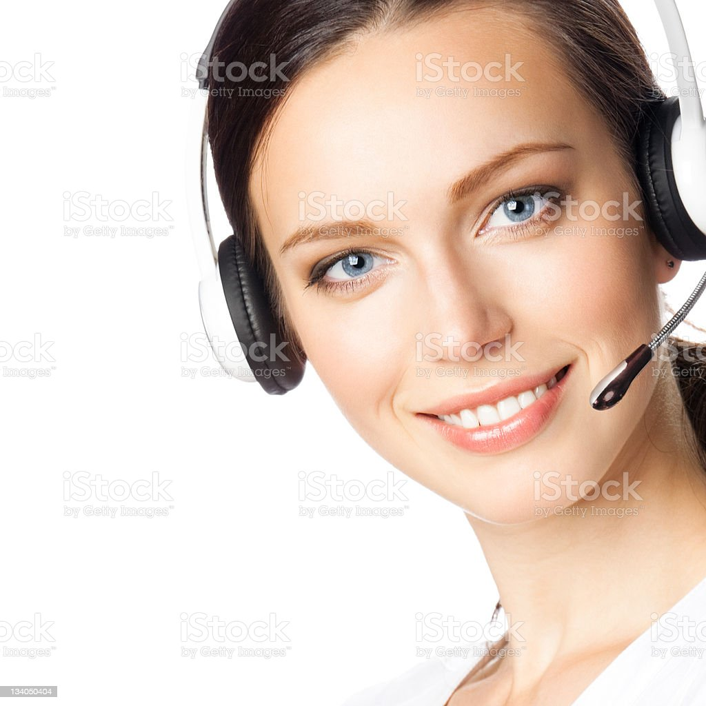 Smiling woman wearing phone headset over a white background royalty-free stock photo
