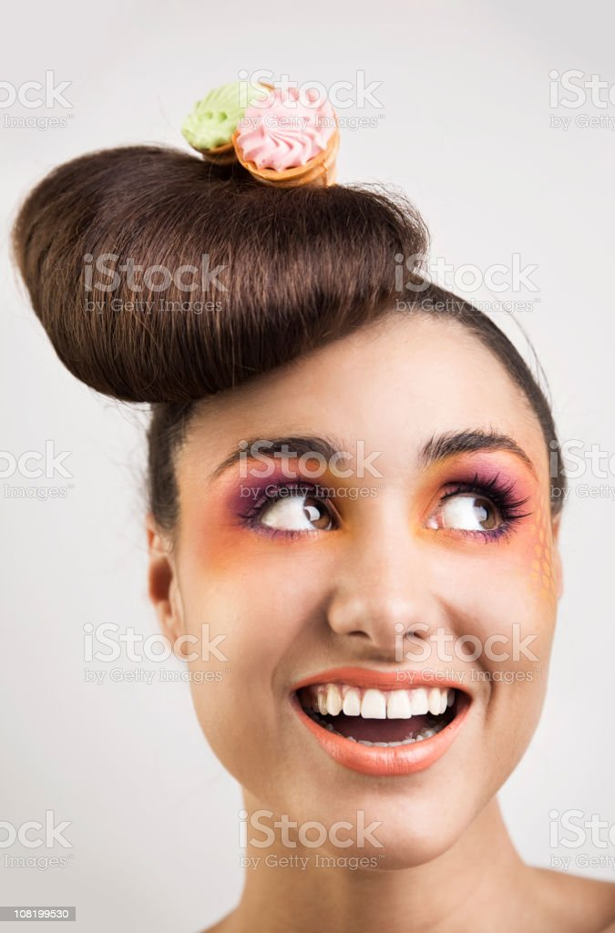 Smiling Woman Wearing Small Ice Cream Cones in Hair royalty-free stock photo